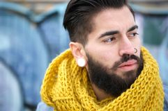 Portrait man with beard and scarf outdoors Royalty Free Stock Photos