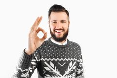 Portrait of a man with a beard, showing a gesture of approval, gesture well royalty free stock photography
