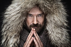 Portrait of man with beard in winter clothes. Wolf Stock Photography
