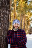 Portrait of a man with a beard in winter. Portrait of a man with a beard in the winter in the forest Stock Photo
