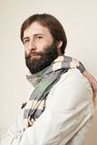 Portrait of the man with a big beard and mustaches. Portrait of the young man with a big beard and mustaches on a white background Stock Photography