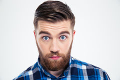 Portrait of a man with big eyes looking at camera Stock Images