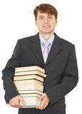 Portrait of man with big pile of books. Portrait of the man with the big pile of books isolated on a white background Royalty Free Stock Images