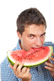 Portrait of man bite water melon stock images