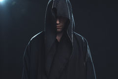 Portrait of man in a black robe Stock Photos