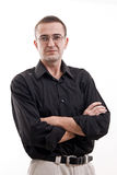 Portrait of man in black shirt wearing glasses. Stock Images