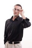 Portrait of man in black shirt wearing glasses. Stock Photo