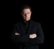 Portrait of man in black suit Stock Photos