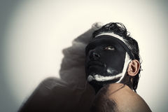 Portrait of man with black theatrical makeup Royalty Free Stock Image