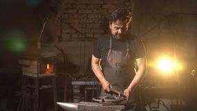 Portrait of a man of a blacksmith in the working atmosphere. Portrait of a man of a blacksmith in the working atmosphere Royalty Free Stock Photography