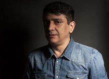 Portrait of man in Blue jean shirt. On black background Royalty Free Stock Image