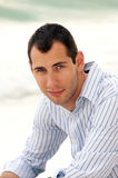 Portrait of man in blue shirt looking at viewer Royalty Free Stock Image