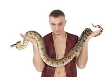 Portrait of man with boa snake Stock Photography
