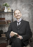 Portrait of man with a book. Intentional 1900's style expression emulation Royalty Free Stock Photography