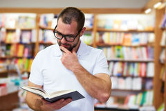Portrait of a man in a bookstore Royalty Free Stock Image