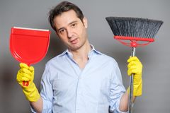 Man tired of domestic work holding broom royalty free stock photos