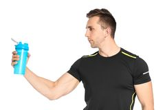 Portrait of man with bottle of protein shake. On white background stock photo