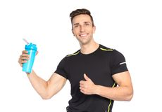 Portrait of man with bottle of protein shake. On white background royalty free stock photo