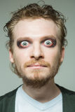 Portrait of a man with bulging eyes. Makeup Royalty Free Stock Images