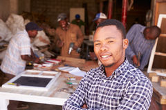 Portrait of man in a busy carpentry workshop, South Africa Stock Images