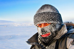 Portrait of a man in a cap and a ski mask. Royalty Free Stock Image