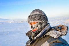 Portrait of a man in a cap and a ski mask. Stock Images