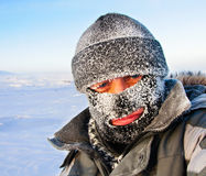 Portrait of a man in a cap and a ski mask. Stock Photography