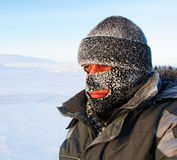Portrait of a man in a cap and a ski mask. Royalty Free Stock Photo