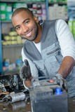Portrait man with car battery Royalty Free Stock Image