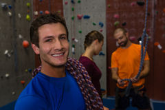Portrait of man carrying climbing rope in gym Royalty Free Stock Photos