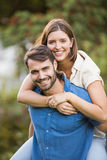 Portrait of man carrying woman. Portrait of men carrying women at park royalty free stock photography