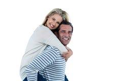 Portrait of man carrying woman piggyback Royalty Free Stock Photos