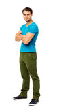 Portrait Of Man In Casuals Standing Arms Crossed Stock Photo