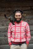 Portrait of man and cat. Portrait of young hipster man with beard and cat in front of wooden house Royalty Free Stock Photos