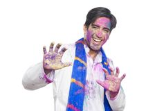 Portrait of a man celebrating Holi Stock Image