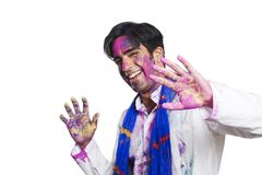 Portrait of a man celebrating Holi Stock Photos