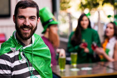 Portrait of man celebrating St Patricks day. Portrait of men celebrating St Patricks day with friends Stock Photos