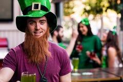 Portrait of man celebrating St Patricks day. Portrait of men celebrating St Patricks day with a green pint Royalty Free Stock Photo