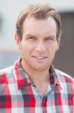 Portrait of man in a checkered shirt. Outdoor shoot Stock Images