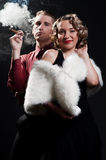Portrait of man with cigar and chic woman Royalty Free Stock Photos