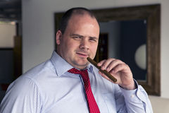 Portrait of a man with a cigar Royalty Free Stock Photos