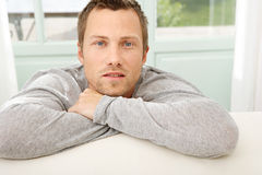 Portrait of man by couch. Stock Images