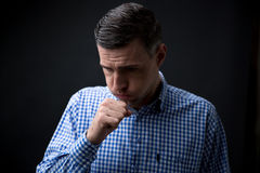 Portrait of a man coughing Stock Photography