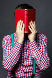 Portrait of a man covering his face with a  book Royalty Free Stock Photos