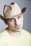 Portrait of a man. Man in a cowboy hat a weary expression on his face royalty free stock photos