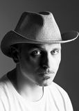 Portrait of a man. Man in a cowboy hat a weary expression on his face stock photos