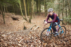 Portrait of man cross-country cycling in a forest Royalty Free Stock Photo