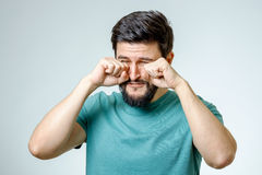 Portrait of man is crying isolated royalty free stock images