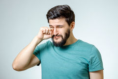 Portrait of man is crying isolated Royalty Free Stock Photos