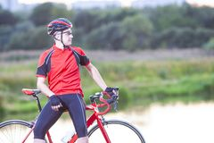 Portrait of Man Cyclist Relaxing with Road Bicycle Outdoors on N Stock Photography